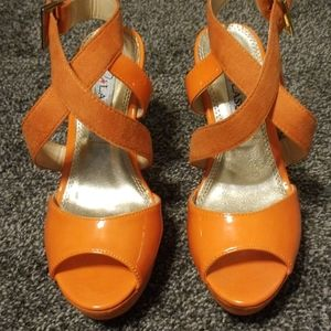 NWOT orange wedge heels